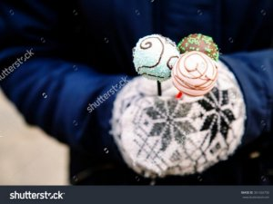 stock-photo-girl-s-hands-in-warm1-winter-gloves-with-ornament-holding-traditional-christmas-festive-sweets-361426730-640x470