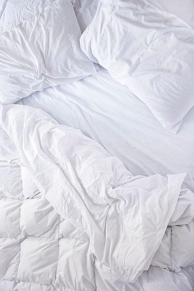 Приклад фотографії із розстеленим ліжком